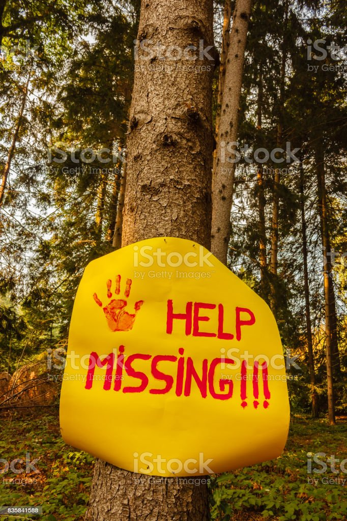 a sign reading help missing stock photo