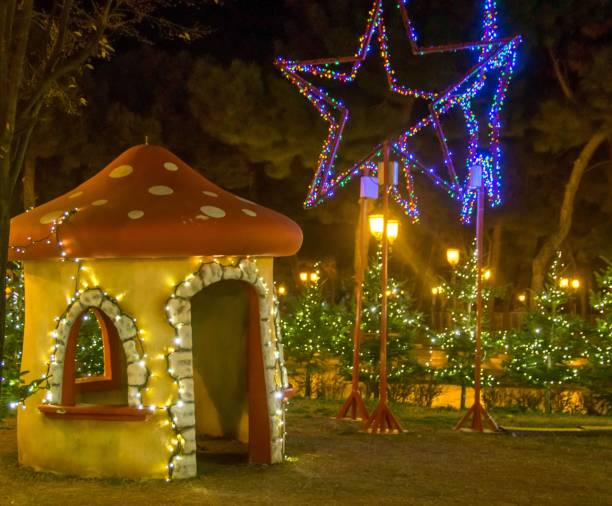 a small christmas house in the shape of a mushroom in a park - deign stock pictures, royalty-free photos & images