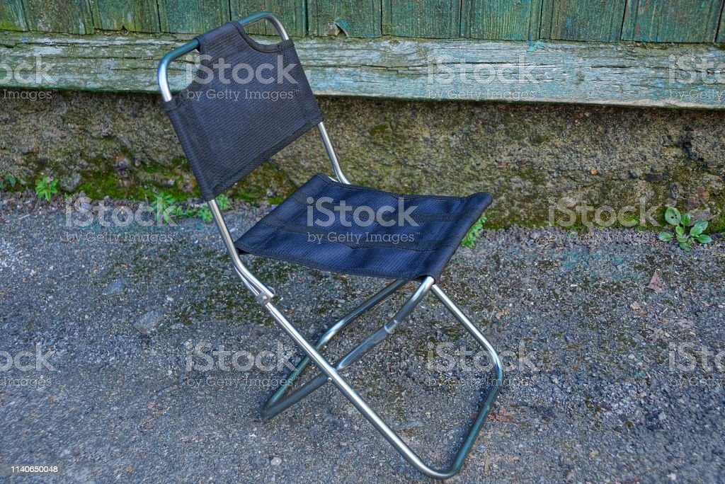 Marvelous A Small Folding Metal Chair With Black Matter Stands On The Cjindustries Chair Design For Home Cjindustriesco