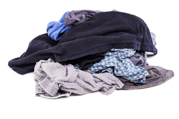 a small pile of clean and dry panties and t-shirts - isolated on white background stock photo