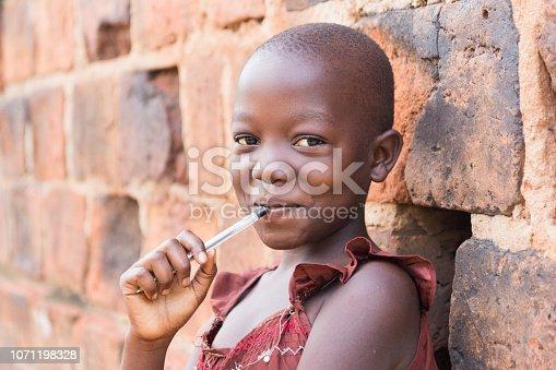 istock a smiling Ugandan girl 1071198328