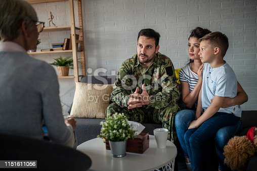 istock a soldier and his family at a psychotherapist during a session 1151611056