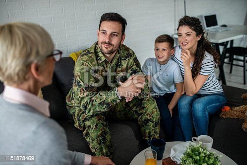 istock a soldier and his family at a psychotherapist during a session 1151878469
