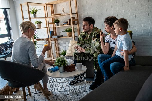 istock a soldier and his family at a psychotherapist during a session 1151879095