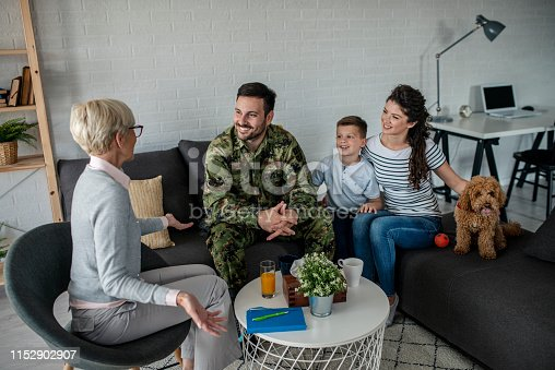 istock a soldier and his family at a psychotherapist during a session 1152902907