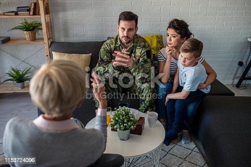 istock a soldier and his family at a psychotherapist during a session 1153724096