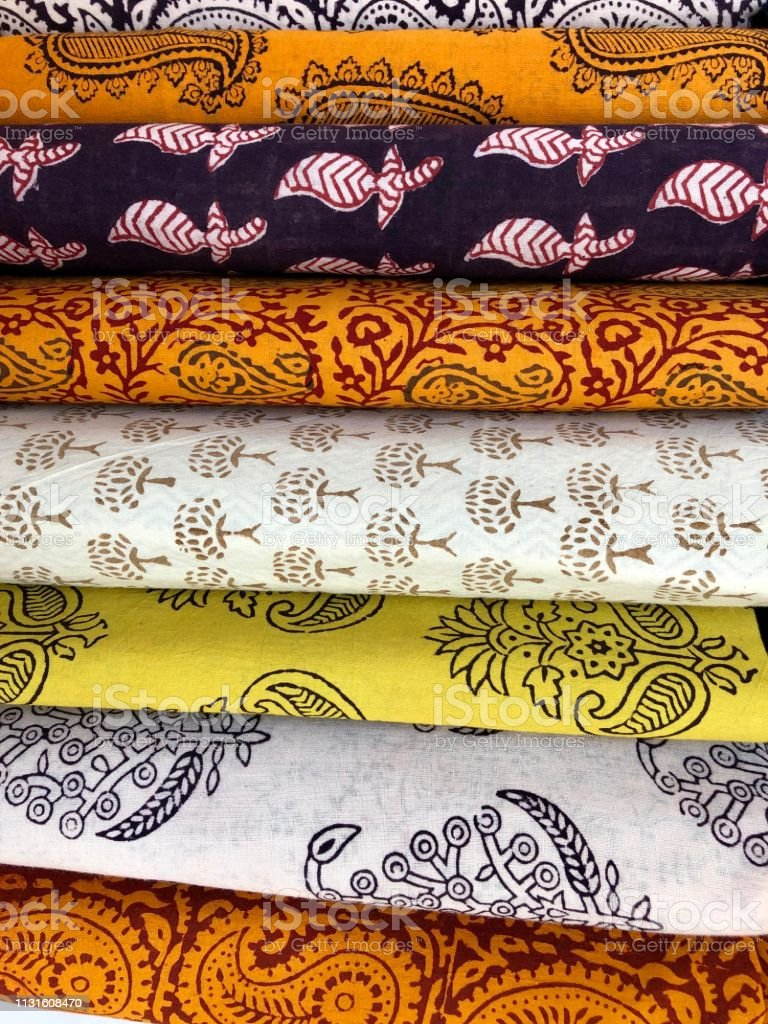 A Stack Of Bright Multicolored Fabrics With Indian Ornaments Stock ...