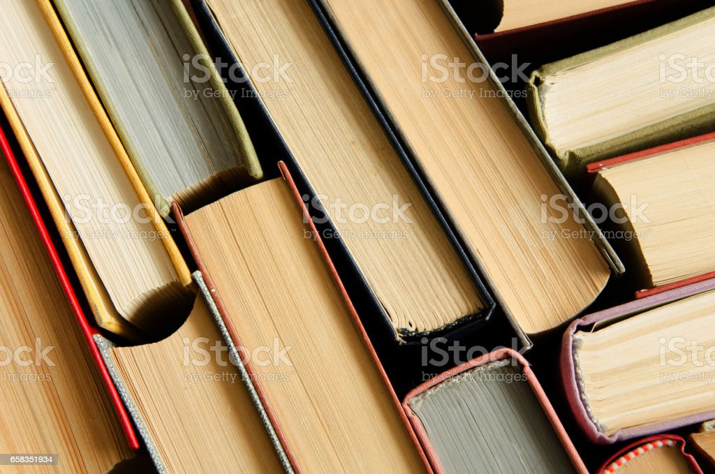 a stack of colorful books in a library stock photo