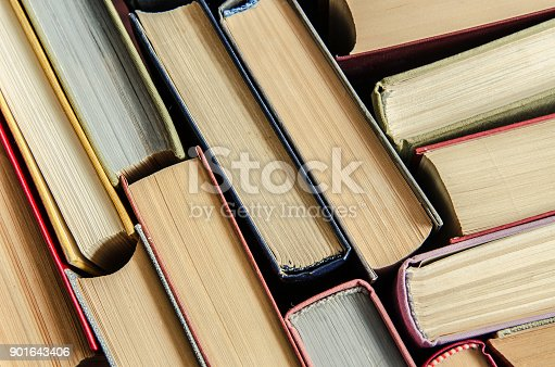 istock a stack of colorful books in a library 901643406