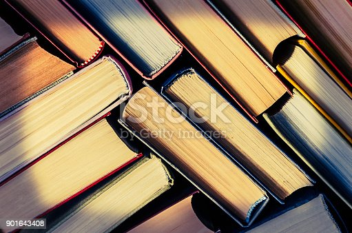 istock a stack of colorful books in a library 901643408