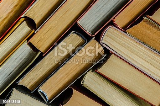a stack of colorful books in a library or a room