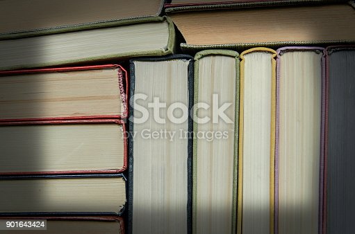 istock a stack of colorful books in a library 901643424