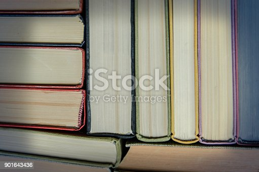 istock a stack of colorful books in a library 901643436