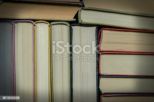 istock a stack of colorful books in a library 901643438