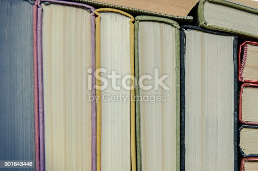 istock a stack of colorful books in a library 901643446