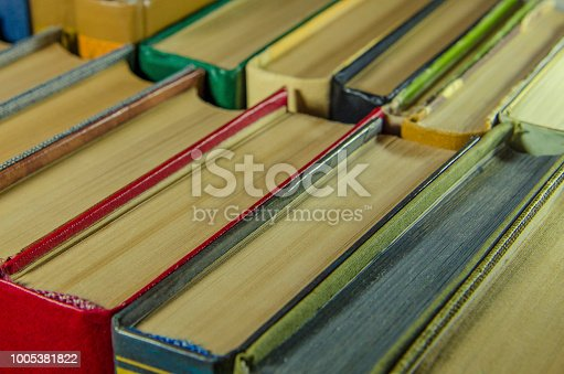 istock a stack of colorful books on the shelf 1005381822