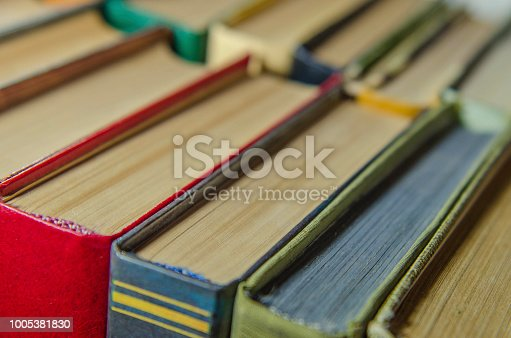 istock a stack of colorful books on the shelf 1005381830