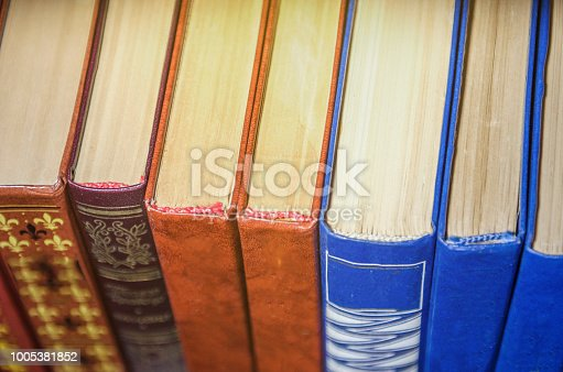 istock a stack of colorful books on the shelf 1005381852