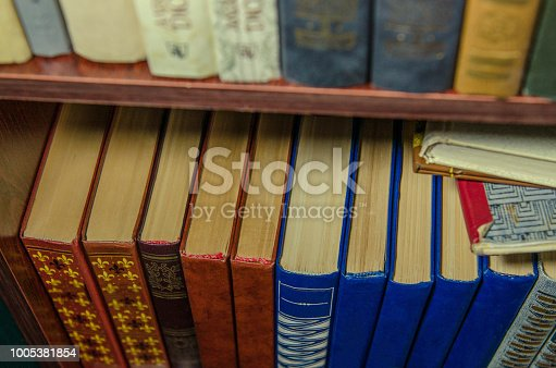 istock a stack of colorful books on the shelf 1005381854