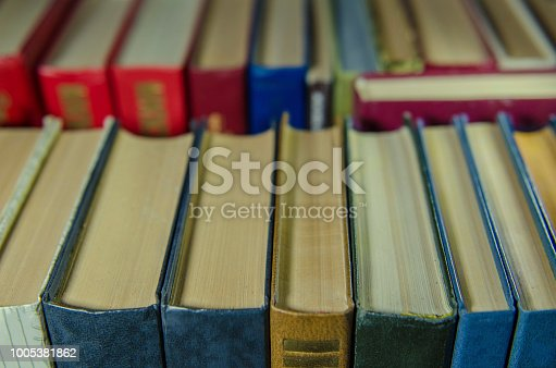 istock a stack of colorful books on the shelf 1005381862