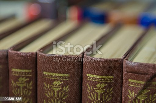 istock a stack of colorful books on the shelf 1005381866
