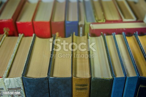 istock a stack of colorful books on the shelf 1005381868