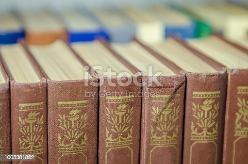 istock a stack of colorful books on the shelf 1005381882