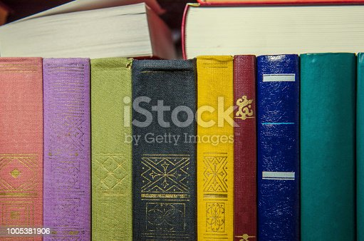 istock a stack of colorful books on the shelf 1005381906