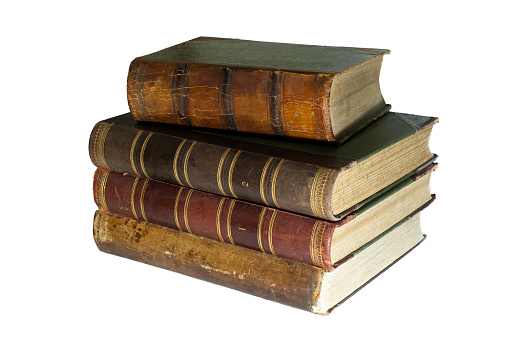 A stack of four ancient books isolated
