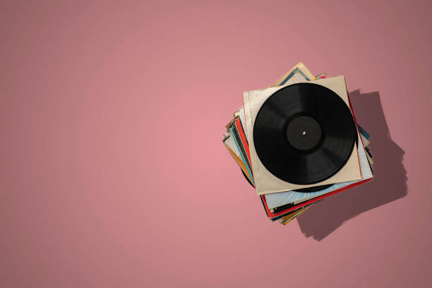 a stack of old vinyl discs, abstract retro music collection from the 80s, disco jazz blues sounds stock photo
