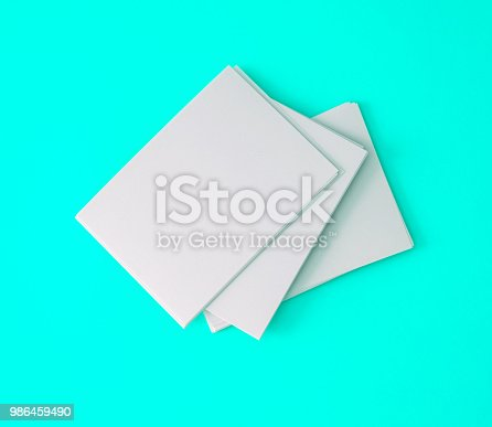 968272356istockphoto a stacking of mockup empty white business card  on a vibrant blue background , template for business  branding  design 986459490