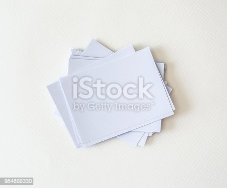 968272356istockphoto a stacking of mockup empty white business card  on white paper background , template for business  branding identity design 954866330
