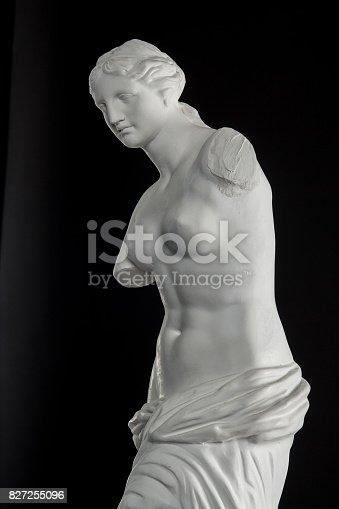 868668568 istock photo a statue of Venus, plaster column on a black background 827255096