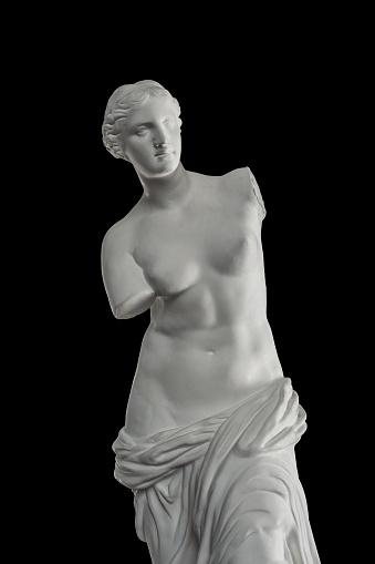 a statue of Venus, plaster column on a black background