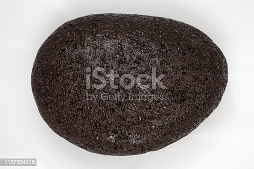 istock a stone with many holes in its surface. 1137504215