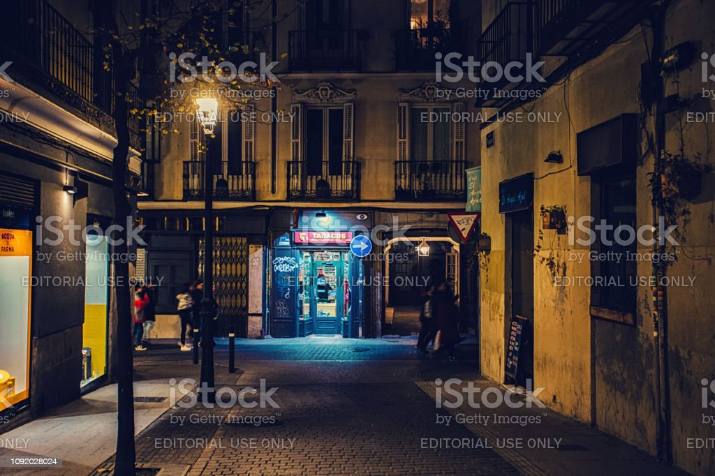 a store lit up at night stock photo