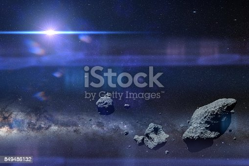 istock a swarm of asteroids in front of the Milky Way galaxy and the Sun (3d space illustration, elements of this image are furnished by NASA) 849486132