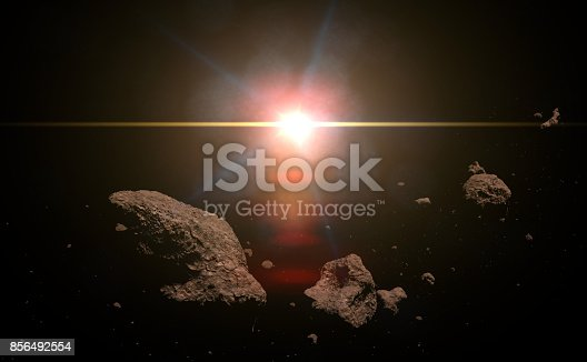 istock a swarm of asteroids lit by the bright Sun 856492554