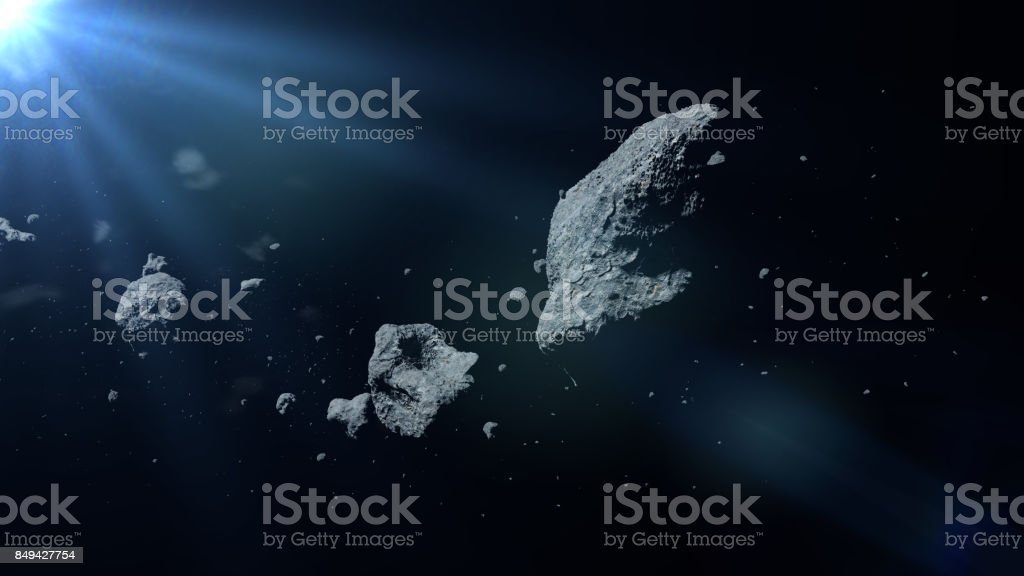 a swarm of asteroids lit by the Sun stock photo