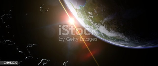 istock a swarm of asteroids moving towards planet Earth 1036682030