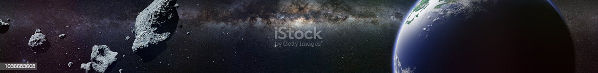 istock a swarm of asteroids moving towards planet Earth 1036683608