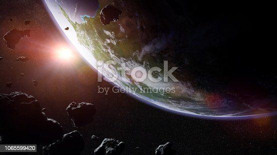 istock a swarm of asteroids moving towards planet Earth 1065599420
