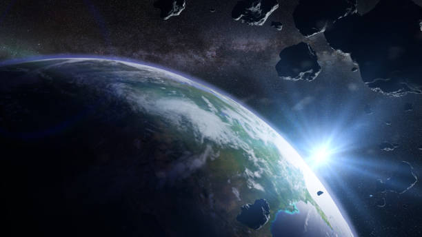 a swarm of asteroids moving towards planet Earth stock photo
