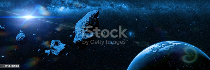 istock a swarm of asteroids moving towards planet Earth 912004590