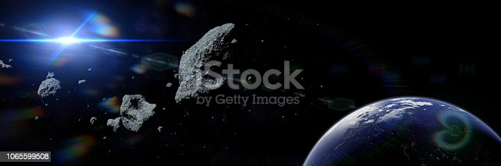 istock a swarm of gigantic asteroids moving towards planet Eart 1065599508