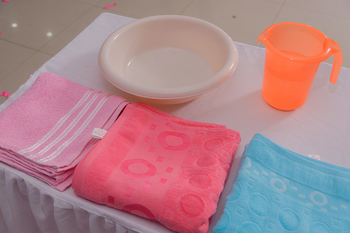 618327092 istock photo a table with towels, a laver and a glass of water 881845394