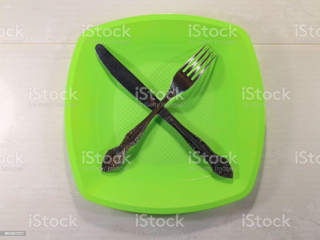uma colher de sopa em um prato verde - Foto de stock de Alimentação Saudável royalty-free