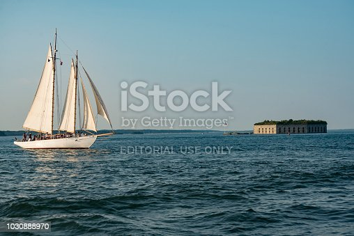 Portland ME - August 5: a Tall ship passing Fort Gorges on Hog Island Ledge in the Casco Bay at the entrance to the harbour on August 5, 2018 in Portland, Maine