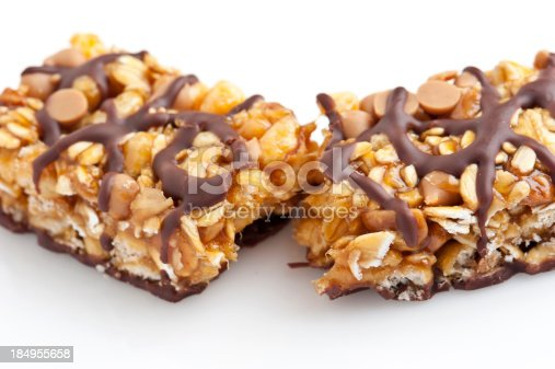 Chocolate and peanut butter energy bar close up on white background