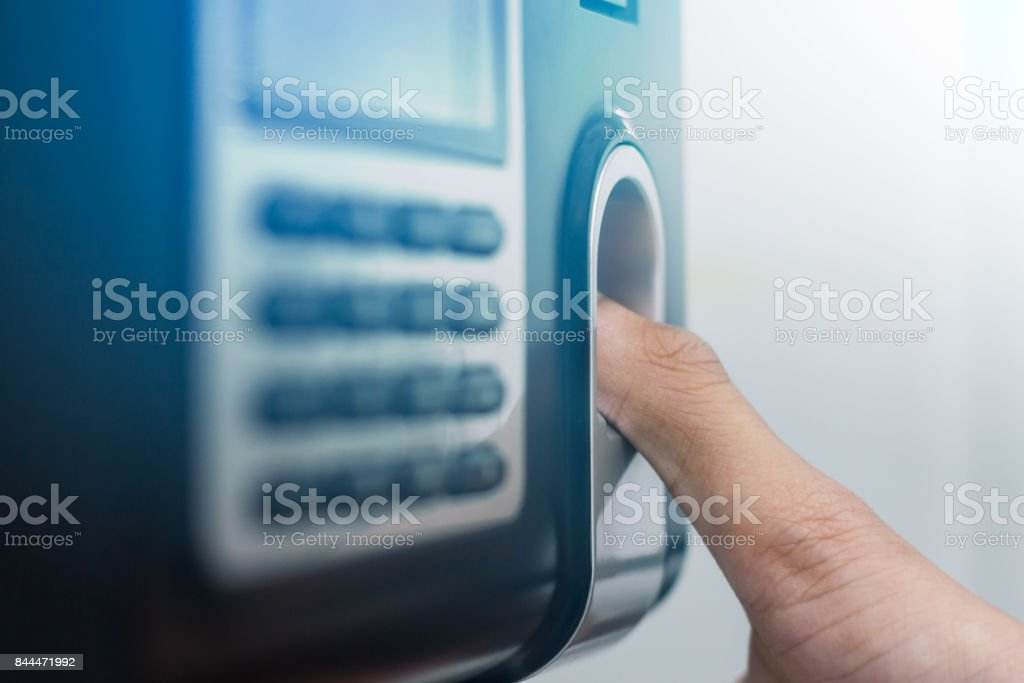 a Thumb place on Fingerprint Scanner stock photo